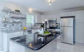 kitchen with black satin granite countertop and mosaic tile backsplash