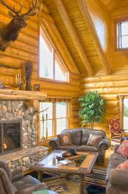 log home stone fireplace with elk above
