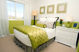 even a small amount of a lively paint color can invigorate a bedroom this room doesn t get much natural light so the designer used shades of pear to give