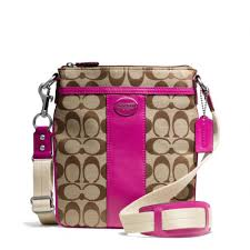 The Legacy Swingpack In Signature Fabric from Coach. I love the crossbody  design for easy shopping and family outings.