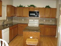 honey oak cabinets what color countertop what color granite on kitchen walls
