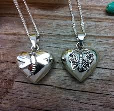 able to hold hair or ashes and comes with sterling silver chain stunning 3d effect with attached erfly or dragonfly 180 in sterling silver solid 9ct