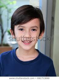 portrait of a cute little boy mixed asian european smiling face of a cute boy