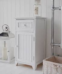 white wooden bathroom furniture. A Crisp White Freestanding Bathroom Storage Furniture. Narrow Cabinet With One Drawer And Cupboard, Each Wooden Knob Tongue Furniture