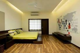 bedroom with wooden flooring and false ceiling