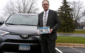 david lameyer of north st paul minn holds his personalized license plate