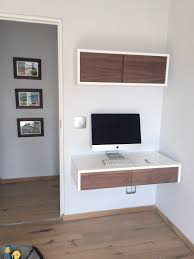 ODE home office with floating desk and floating box with sliding doors.  This is white