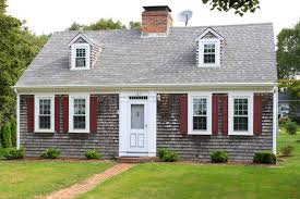 New England House With Grey Shingles, Two Small Dormers Without Shutters,  Red Shutters On
