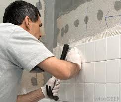 laying tile in bathroom. Installing Ceramic Tiles Can Ensure Waterproofing And Durability Of Bathroom Walls Floors. Laying Tile In