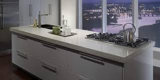 zodiaq quartz countertop on kitchen island in urban loft with city view