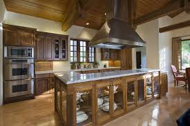 Wooden Kitchen Design With Large Island And Large Stainless Oven Hood