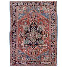 antique heriz serapi persian carpet with geometric medallion in red and blue for