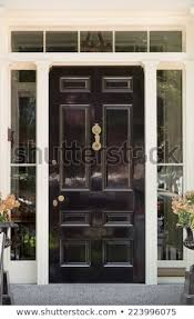 black front door with white door frame and windows