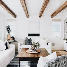 bright white living room with exposed wood ceiling beams ceiling beams living room i87 beams