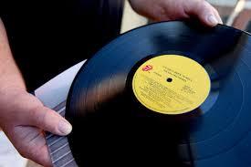 A Rolling Stones fan holds a vinyl LP. Paul Kane/Getty Images