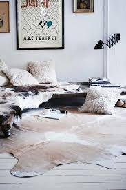 faux hide rug really encourage white walls cowhide fur pillows styling decor regarding