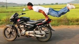 motorbike yoga man pulls yoga poses on speeding bike youtube
