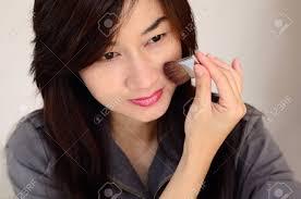 asia woman makeup your face make up closeup cosmetic powder brush stock