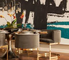 incredible chic dining room features large teal and black abstract art gold dining room chairs ideas