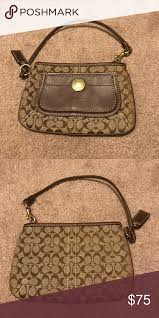 Coach Wristlet Classic Coach monogrammed wristlet- never been used but no  tags Coach Bags Clutches