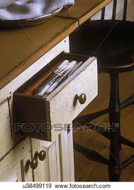kitchens detail of silverware drawer in island cream color distressed custom made cabinets early american styling dividers in drawer pearl handled
