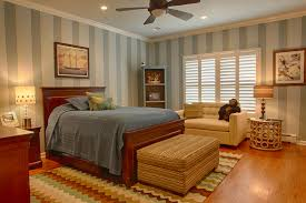 chic ceiling bedroom lighting with fan over cherry wooden single beds with brown long pouffe on bedroom cool bedroom wallpaper baby nursery