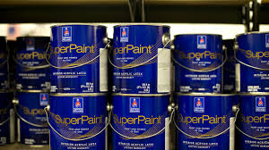 gallon cans of sherwinwilliams superpaint a bination paint and primer sit on a shelf