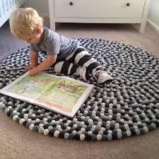 felt ball rug in grey light blue off black white round