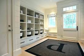 beach style rugs mudroom rugs monogram area rug built in entry beach style with white runner