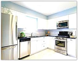 kitchen with stainless steel appliances cream colored kitchen cabinets with stainless steel appliances kitchen with stainless steel appliances white