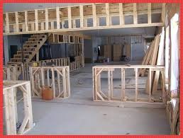 framing a half wall to the right beyond the half wall will be the restaurant behind framing a half wall