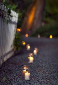 spooky lighting. tea lights in glasses lining a path or driveway spooky lighting
