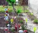 Поделки из бутылок в саду своими руками фото 152