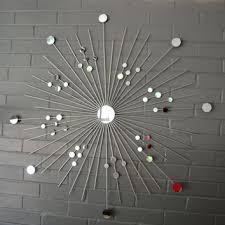 36 inch metal starburst wall art in silver metallic hand welded