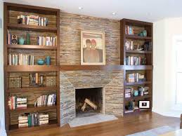 decorative stone fireplace for modern family room ideas with wooden wall mounted bookcase design