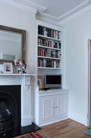 built in bookcase for living room right alcove cupboard covering gas box