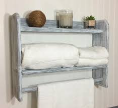 white bathroom shelves with towel bar