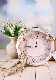 beautiful vintage alarm clock with flowers on light background stock photo 30039186 beautiful l71