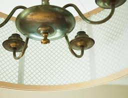 a plain chandelier looks so much better under a diy drum shade