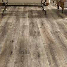 restoration wide plank 8 x laminate flooring in brushed gray grey vinyl with oak cabinets