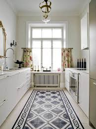 if an overall encaustic tile is too overwhelming you can instead pair them with plain tiles to create an eye catching tile rug pattern like this one
