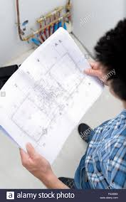 Plumber Looking At Plans Stock Photo 213250620 Alamy