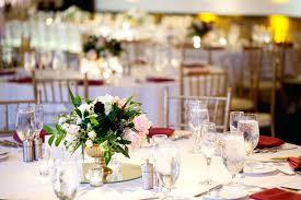 round wedding tables fl centerpiece in gold urn on round mirror round mirror centerpiece wedding flowers