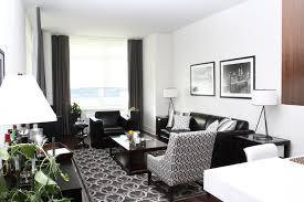 living room black furniture. white trimmed interior with the black furniture and living room t