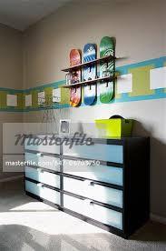 skateboard shelf above dresser in boys room tustin california usa stock photo