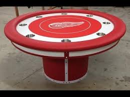 custom poker tables. Round Custom Poker Tables With A Sports Theme