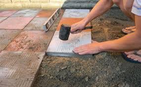 laying paving slabs on soil
