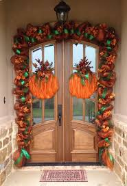 Fall deco mesh garland and pumpkins for front door