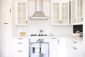 Glass Door KItchen Cabinets With Oil Rubbed Bronze Pulls And Glass Shelves Design Inspirations