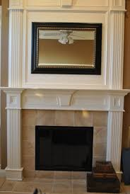 incredible wood fireplace mantel surround plans in white paint color schemes with majestic bi fold glass